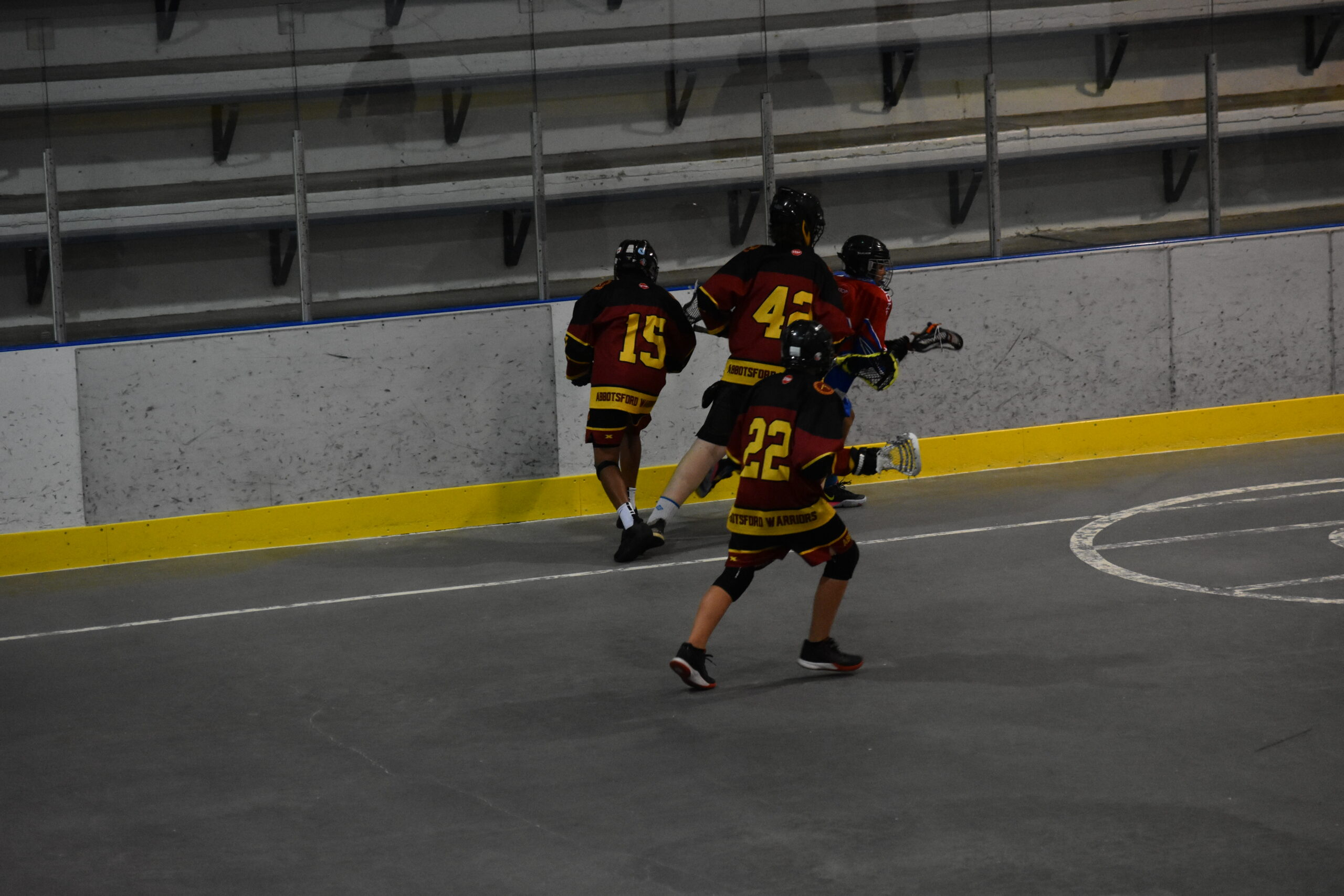 Abbotsford Warriors Lacrosse Players Running During a Game